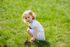 Child with a rabbit on the grass Stock Images