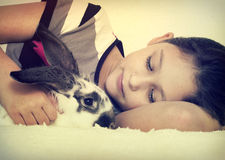 Child and rabbit Royalty Free Stock Image