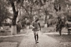 Child in the rain Royalty Free Stock Photography