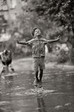 Child in the rain Stock Photography