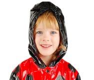Child in rain coat. Royalty Free Stock Photo