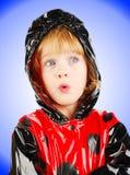 Child in rain coat. Royalty Free Stock Image
