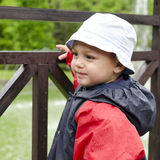 Child in rain Stock Images