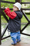 Child in rain Stock Photo