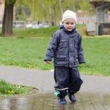 Child in rain Stock Images