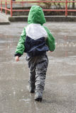 Child in rain Royalty Free Stock Photo