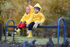 A child in a raincoat for a walk outside stock image