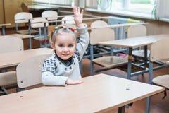 Child raises his hand