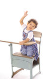 Child raising hand in desk isolated Stock Photos
