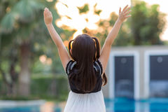 Child Raising Hands Facing Sun Royalty Free Stock Photography