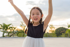 Child Raising Hands with Happiness for Success Royalty Free Stock Photos