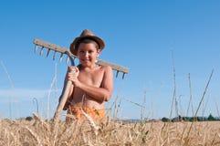 Child with rake stock photography