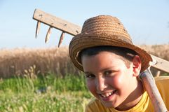 Child with rake Stock Photos