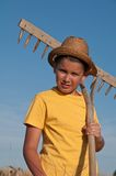 Child with rake Royalty Free Stock Images