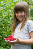 Child with raspberries Royalty Free Stock Photo