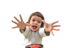 The child reaches for berries. Someone did not eat berries for a long time Stock Photo