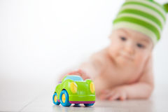 Child reaches to the car Royalty Free Stock Photo