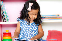 Child read, cute little girl reading a book Royalty Free Stock Photography