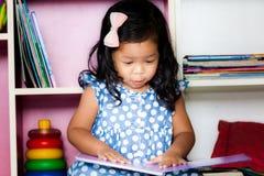 Child read, cute little girl reading a book Stock Photos