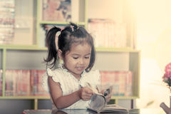Child read, cute little girl reading a book Royalty Free Stock Image