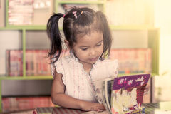 Child read, cute little girl reading a book Stock Photo
