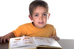 Child reading. At his desk Stock Image