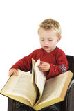 Child is reading Stock Image