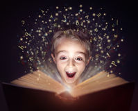 Free Child Reading A Magic Story Book Royalty Free Stock Photo - 78780415