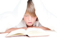 Child reading in bed Stock Image