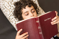 Child Reading the Bible Royalty Free Stock Image