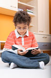 Child reading big glasses Stock Photo
