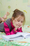 Child reading a book Royalty Free Stock Photography