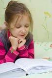 Child reading a book Stock Photos