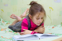 Child reading a book Stock Photos