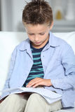 Child reading book Royalty Free Stock Image
