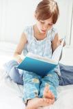 Child reading book Stock Image