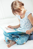 Child reading book Stock Image