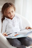 Child reading a book Royalty Free Stock Photo