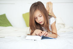 Child reading a book Stock Images