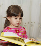 Child reading the book Stock Photo