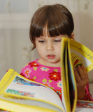 Child reading the book Royalty Free Stock Photo
