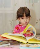 Child reading the book Stock Images