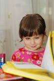 Child reading the book Stock Photos