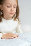 Child reading a book Stock Image