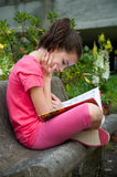 Child reading a book Stock Photo