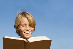 Child reading book or bible Royalty Free Stock Images