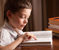 Child reading book Stock Photos