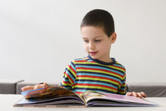 Child reading a book stock photography