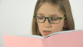 Child Reading a Book, Eyeglasses Portrait Student Kid Learn, Schoolgirl Studying stock image
