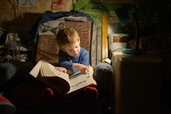 Child Reading a Book. Child In Grandmothers Room, Reading a Book Royalty Free Stock Photos